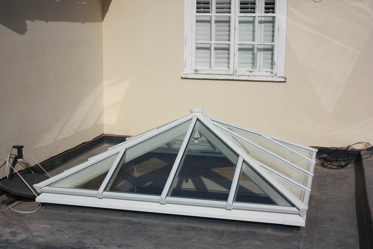 Pointed roof window